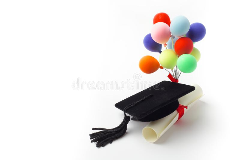 Black Graduation Cap, Degree and balloons Isolated on White Background. royalty free stock photography