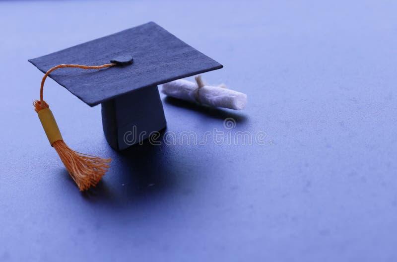Black graduation cap, diploma in classroom. graduate certificat. E program, Education Insight Concept royalty free stock photography