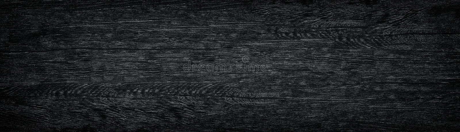 Black grain wooden panoramic texture. Dark long wood background royalty free stock images