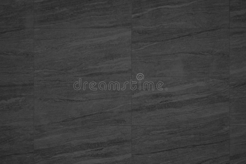 Black granite texture and background or slate tile ceramic, seamless texture square light gray. Marble tiles seamless floor royalty free stock images