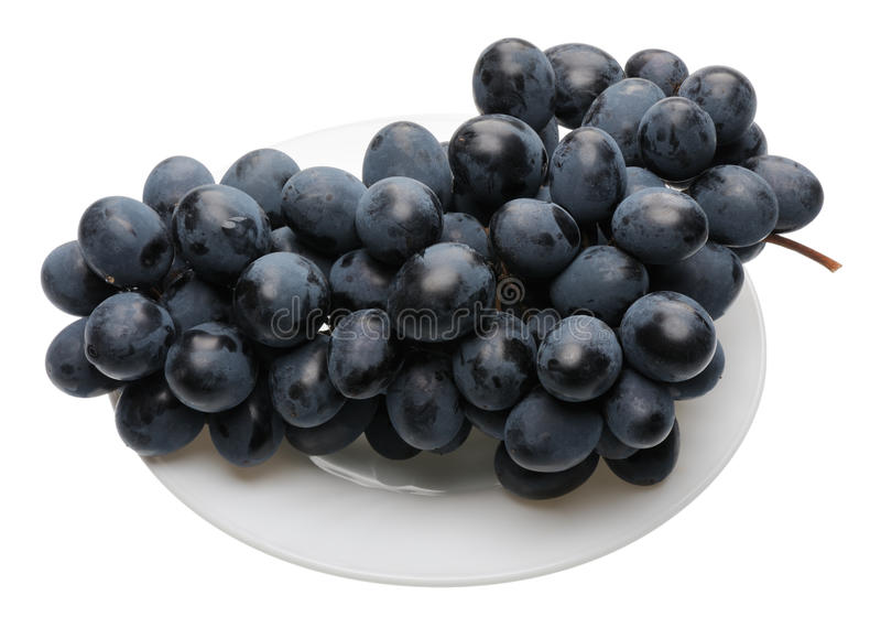 Black grapes on the plate stock image