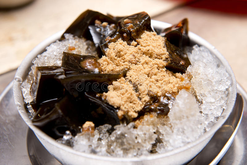 Black grass jelly on ice with brown sugar,Thai dessert royalty free stock images