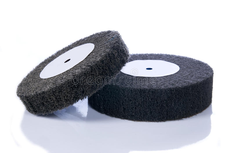 Black and gray, abrasive flap wheels royalty free stock photos