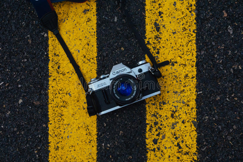 Black And Gray Canon Digital Camera On Black And Yellow Surface Free Public Domain Cc0 Image