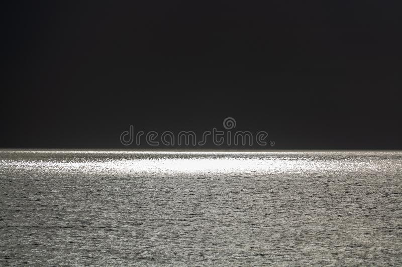 Black and gray concept with sea water surface background, dankness and eternity. Copy space royalty free stock photography