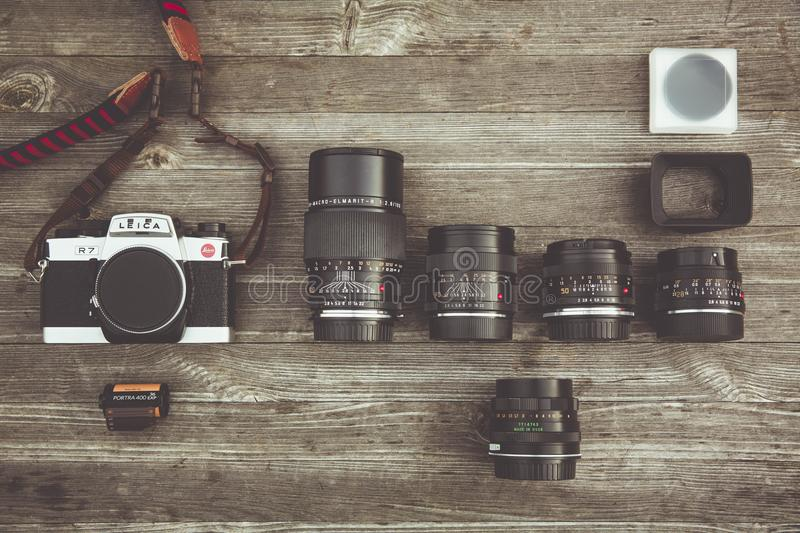 Black and Gray Dslr Camera With Assorted Lenses on Brown Wooden Surface royalty free stock images