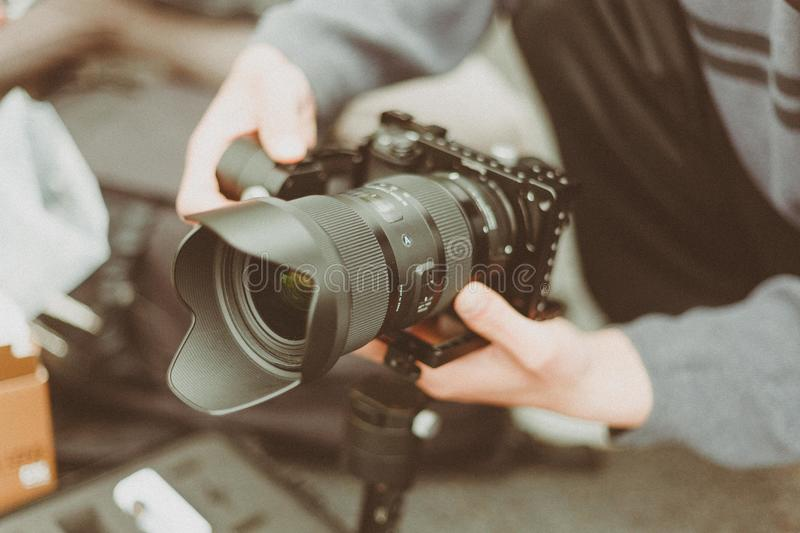 Black and Gray Dslr Camera With Stability Lens stock photo