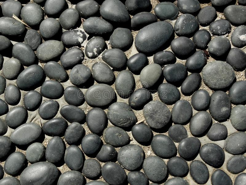 Black and Gray Flat Stones stock images