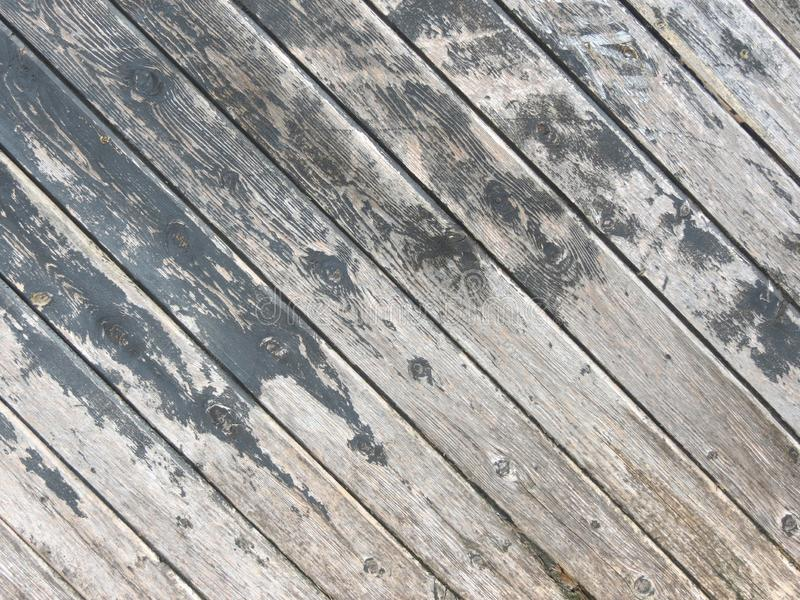 Black gray scratched old rustic wooden background. Wood texture. Close up of wall made of diagonal wood planks vintage royalty free stock photo
