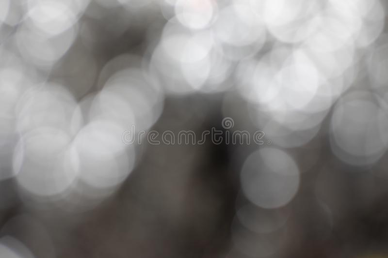Black , gray and white bokeh effect background. Black , gray and white blurry bokeh effect monochrome background concept royalty free stock images