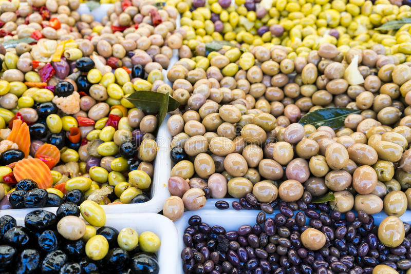 Black and green olives in a French market in Paris, France stock image