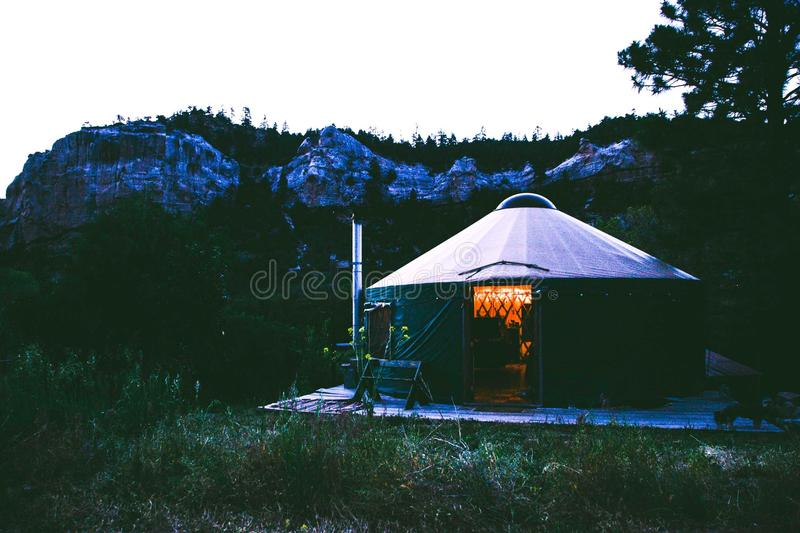 Black And Grey Canopy Tent Near Rocky Mountains royalty free stock photography