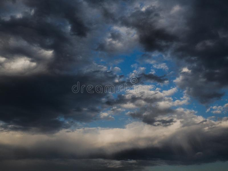 BlAck and grey clouds in summer storm. White, sky, blue, dark, afternoon, dramatic, atmosphere, rain, outdoor, infinity, univers, space stock photography