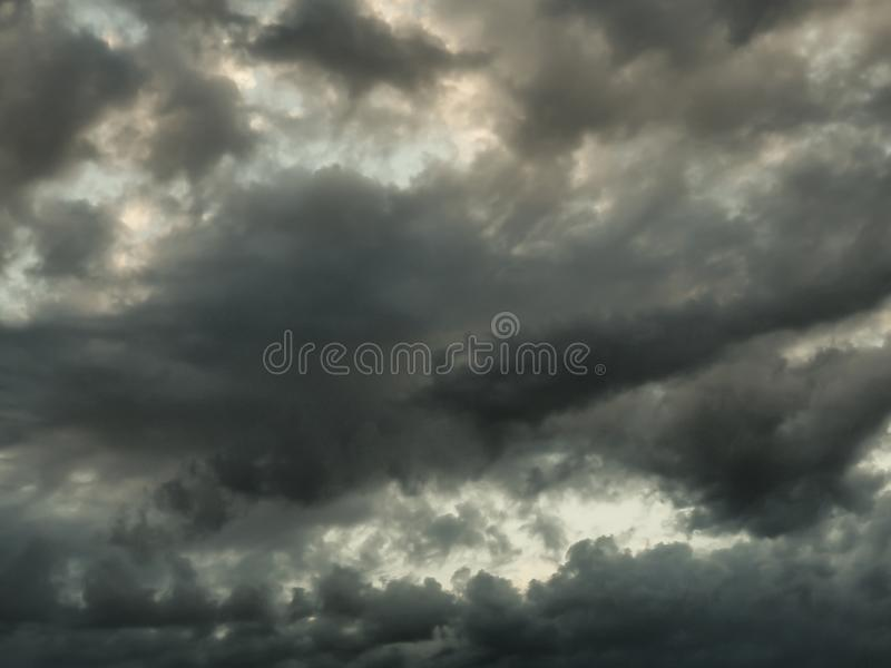 BlAck and grey clouds in summer storm. White, sky, blue, dark, afternoon, dramatic, atmosphere, rain, outdoor, infinity, univers, space stock images