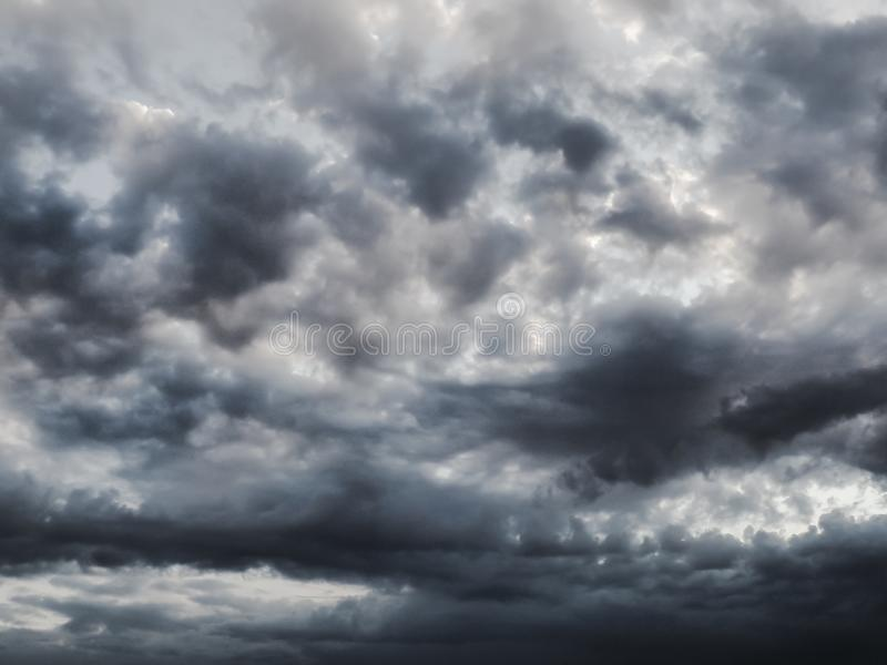 BlAck and grey clouds in summer storm. White, sky, blue, dark, afternoon, dramatic, atmosphere, rain, outdoor, infinity, univers, space royalty free stock images