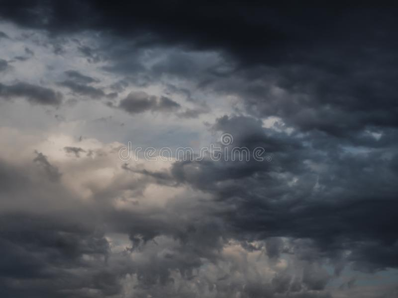 BlAck and grey clouds in summer storm. White, sky, blue, dark, afternoon, dramatic, atmosphere, rain, outdoor, infinity, univers, space royalty free stock photography
