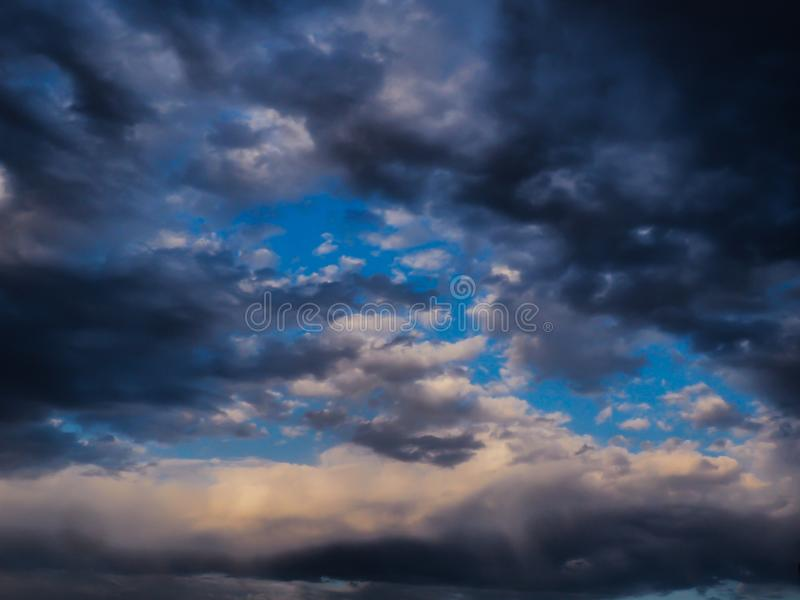 BlAck and grey clouds in summer storm. White, sky, blue, dark, afternoon, dramatic, atmosphere, rain, outdoor, infinity, univers, space stock image