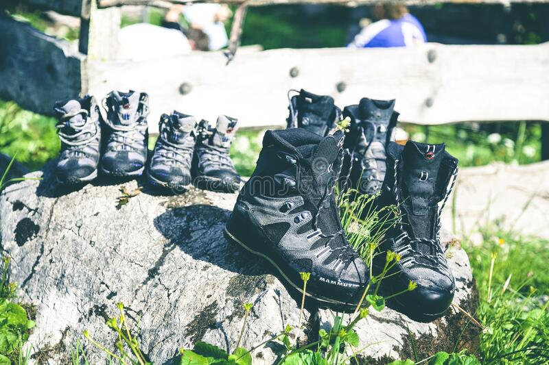 Black And Grey Hiking Shoes On Grey Rock During Daytime Free Public Domain Cc0 Image