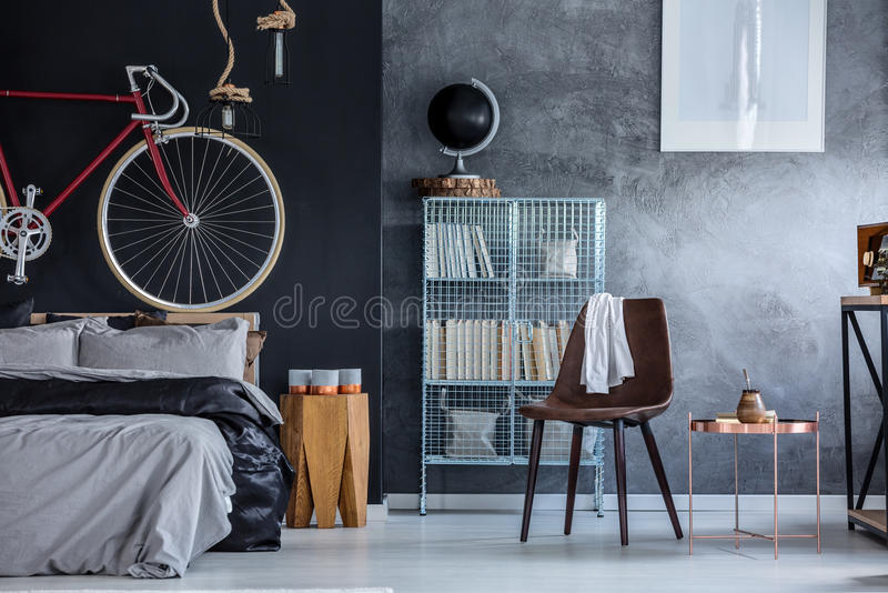 Black and grey walls. In modern spacious bedroom royalty free stock photo