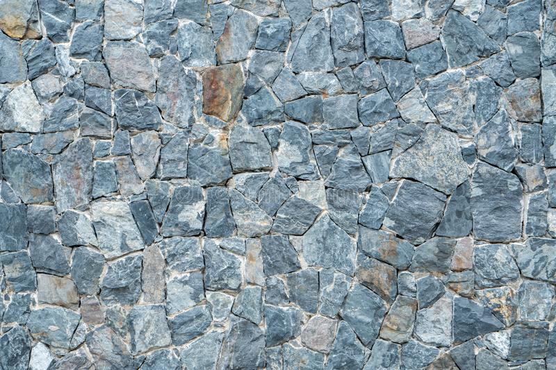 Black, grey and white stone wall background stock images