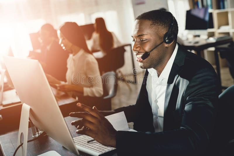 A black guy works in a call center. stock images