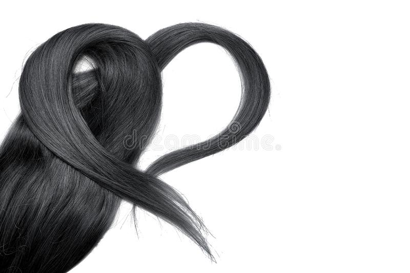 Black hair in shape of heart, isolated on white background. Natural healthy hair isolated on white background. Detailed clipart for your collages and stock images