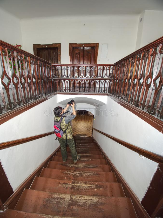 Black hair woman photographer study wooden staircase royalty free stock images