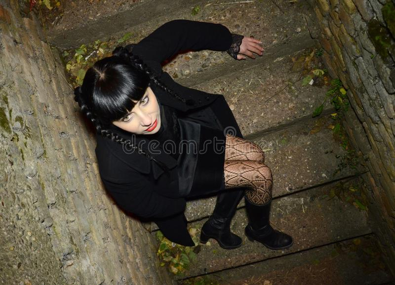 Black hair women on the stairs outhdors stock images