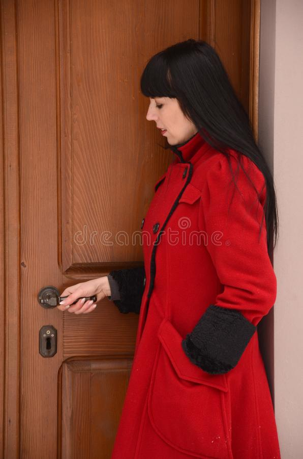 Black hair women on red opened door stock images