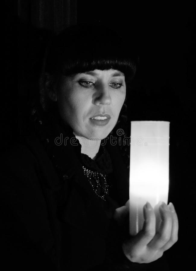 Black hair women on cemetery at night with candle stock photos
