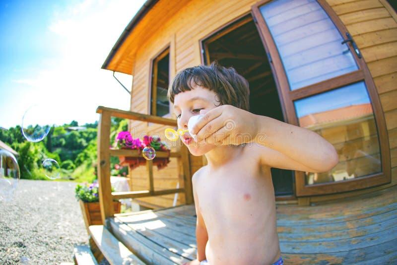 Boy kid blows bubbles. royalty free stock image