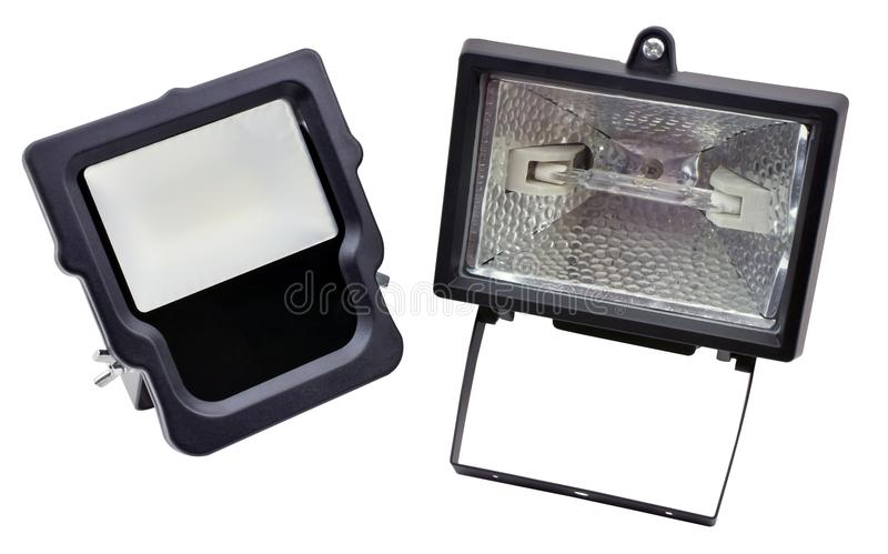Black halogen lantern and led projector on white stock photography