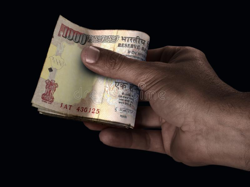 Black Hand And Rupee Cash stock photo
