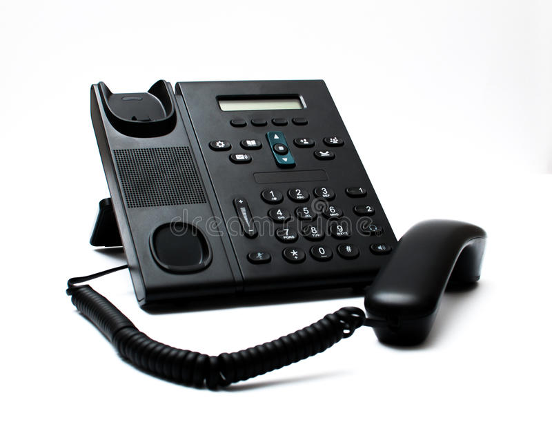 Black handset and a phone stock image