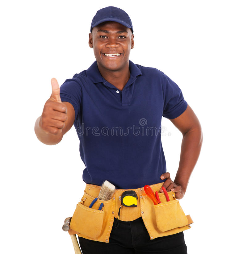 Black handyman thumb up. Happy black handyman giving thumb up on white background stock photography