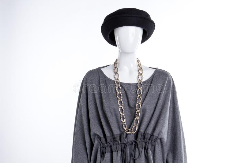 Black hat, grey blouse and chain. stock photos