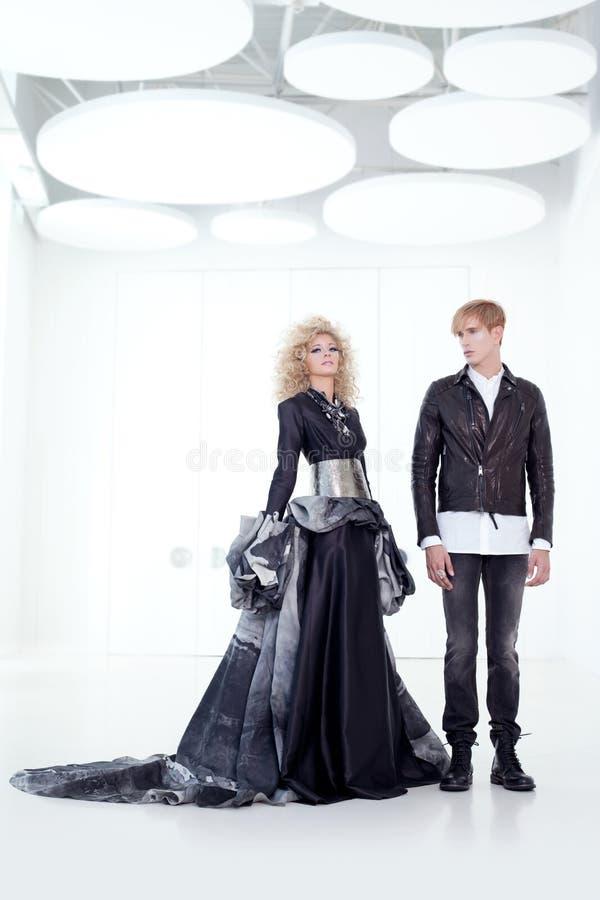 Black haute couture retro futurist couple royalty free stock photos
