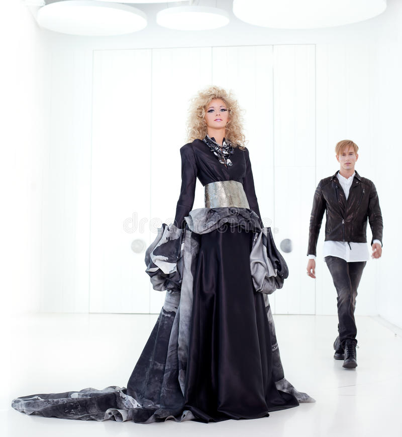 Black haute couture retro futurist couple royalty free stock images