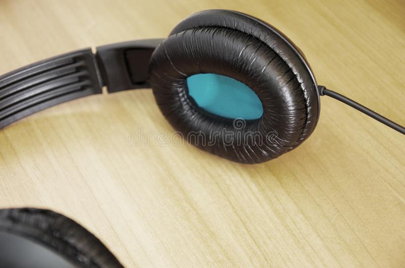 Black headphones on the table. Close-up. Black headphones on the table royalty free stock images