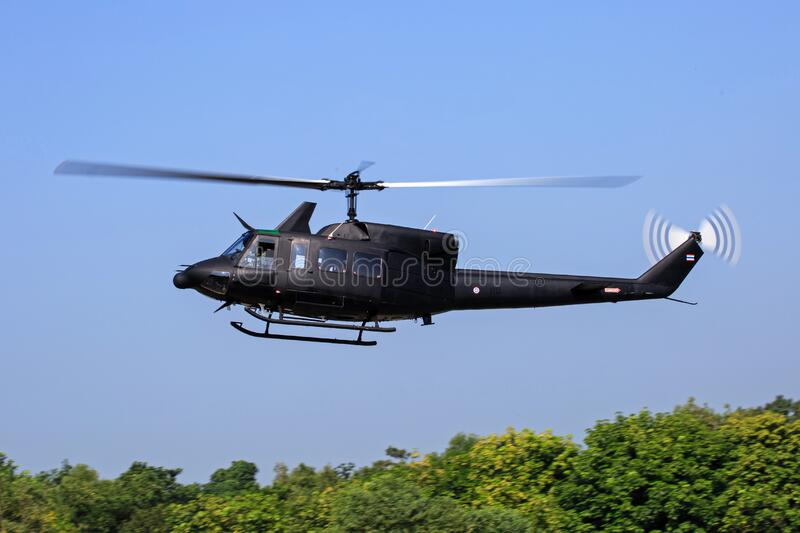 Black Helicopter Flying Above Green Trees Free Public Domain Cc0 Image