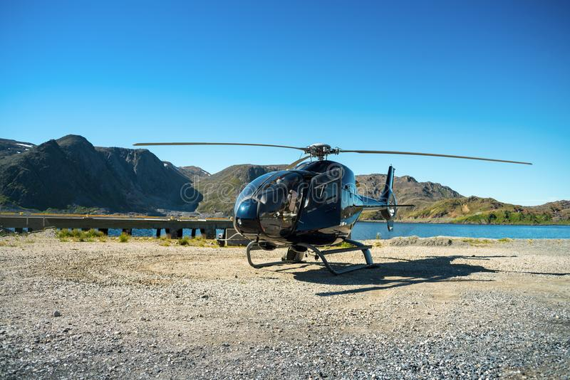 Black Helicopter. A black helicopter is standing on the ground royalty free stock photos