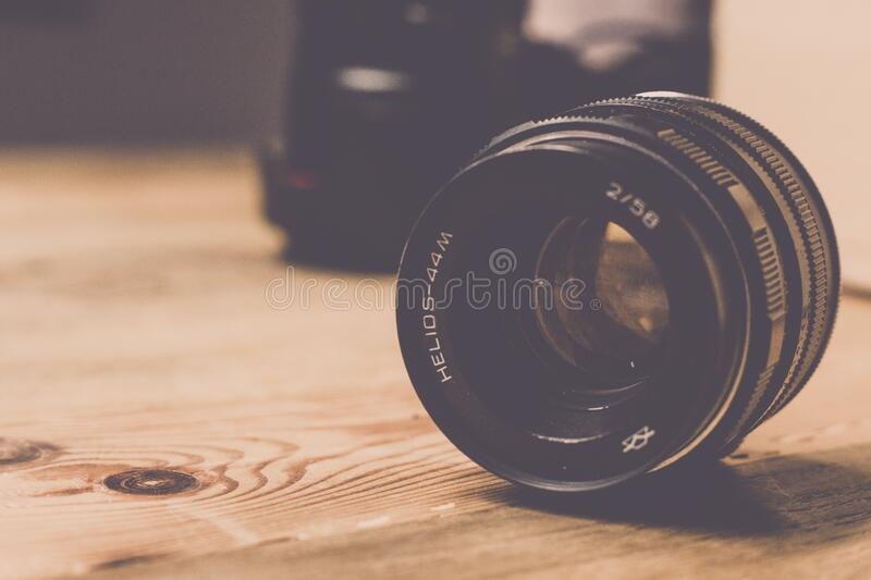Black Helios 44m 2/58 Camera Lens on Brown Wooden Table stock photos