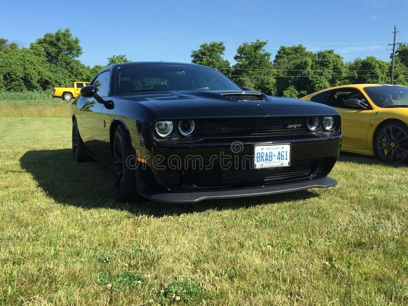 Black hemi powered Challenger at a cars and coffee event in Komoka Ontario stock photos