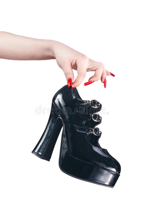 Black high-heel boot. Isolated on white background royalty free stock photos