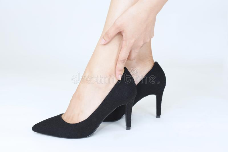 Woman legs in fashionable high heel shoes. Black high heel shoes on women's leg stock photos