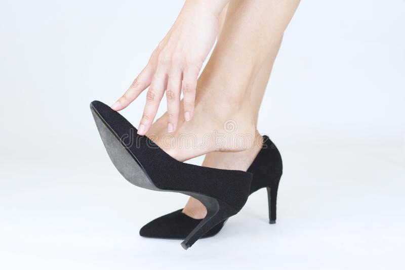Woman legs in fashionable high heel shoes. Black high heel shoes on women's leg royalty free stock images