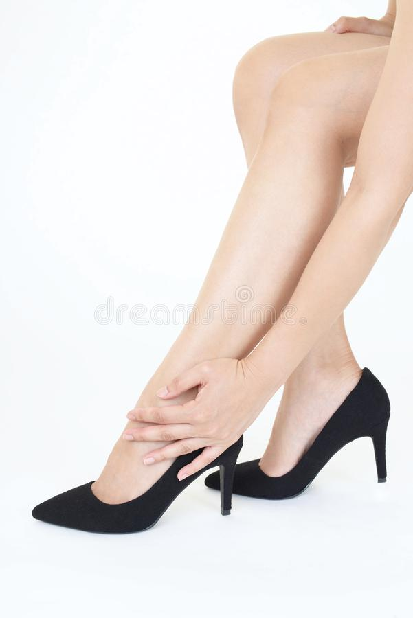 Woman legs in fashionable high heel shoes. Black high heel shoes on women's leg royalty free stock image