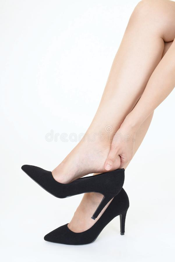 Woman legs in fashionable high heel shoes. Black high heel shoes on women's leg stock photo