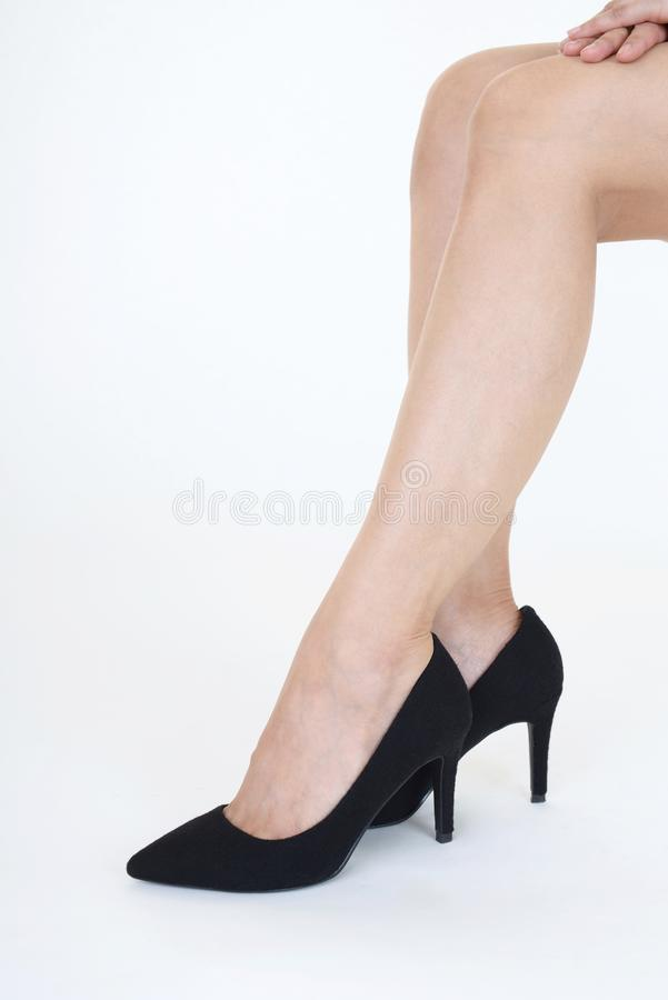 Woman legs in fashionable high heel shoes. Black high heel shoes on women's leg royalty free stock photo
