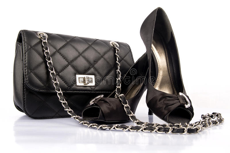Black high heel women shoes and a bag royalty free stock image